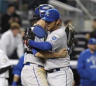 Royals catcher John Buck congratulates closer Joakim Soria, who notches his 30th save of the season.  (AP)