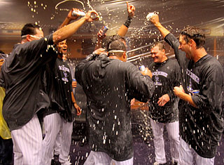 Earning a playoff spot and recording a franchise-record 91st win is worth a champagne shower.  (Getty Images)