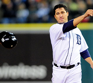 Magglio Ordonez tosses his helmet as the Tigers see their lead in the Central vanish.   (US Presswire)