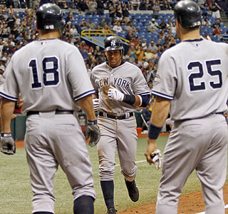 Johnny Damon and Mark Teixeira await Alex Rodriguez following A-Rod's three-run homer in the 6th.  (AP)