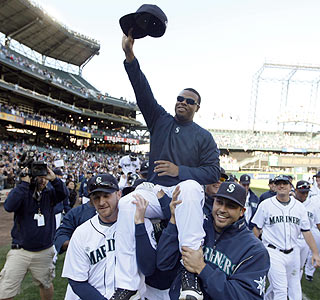 Ken Griffey Jr. gets a ride off the field in what could be the last game of his career.  (AP)