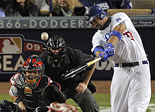 Matt Kemp belts Chris Carpenter's third pitch of the game for a home run and a quick 2-1 lead for L.A.  (AP)