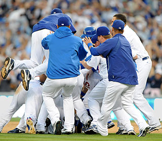The Dodgers celebrate their walk-off victory and can wrap up the series in St. Louis on Saturday.  (US Presswire)