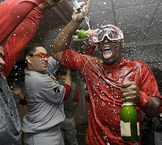 Torii Hunter and the Angels deserve to party after finally beating the Red Sox in a postseason series.  (AP)