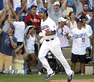 Andre Ethier draws an eighth-inning walk, which eventually wins it to the delight of Dodger fans. (AP)