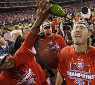 Pedro Martinez douses Jayson Werth in champagne in celebration of a second straight NL pennant.  (AP)