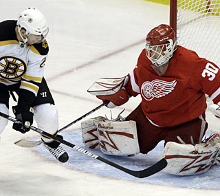 The Bruins can't get anything past Chris Osgood, who records his 50th career clean sheet.  (AP)