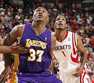 Ron Artest and Trevor Ariza battle to a draw (15 points each), but Artest's team wins.  (Getty Images)