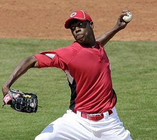 Aroldis Chapman hits 100 mph on the radar gun at least three times in his first start in a Reds uniform.  (AP)