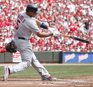 Albert Pujols connects in the first inning to get his two-homer day started against the Reds.  (Getty Images)