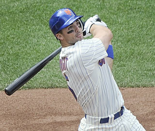 Looking to bounce back from a rough 2009, David Wright hits a two-run shot in the opener.  (AP)
