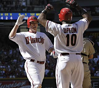 Justin Upton greets Stephen Drew after Drew notches Arizona's sixth inside-the-park homer in its history.  (AP)