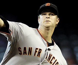 Matt Cain, who pitches well into the seventh inning for the Giants, gives up three earned runs in the no-decision.  (AP)