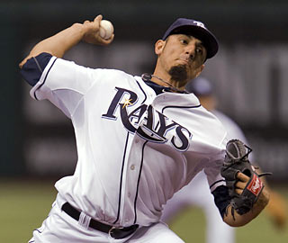Matt Garza struggles early but finishes with nine K's while yielding only four hits through eight innings.  (AP)