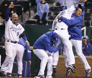 Teammates swarm Willie Bloomquist moments after the pinch runner scores the winning run in the 11th. (AP)