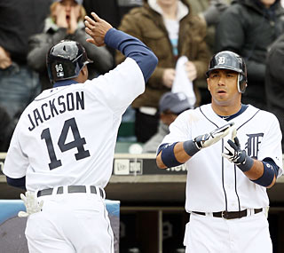 Austin Jackson scores one of Detroit's four runs in a pivotal fifth inning.  (Getty Images)