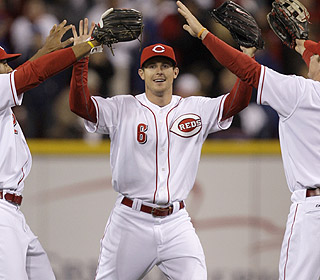 Drew Stubbs is the man of the night as his eighth-inning grand slam gives the Reds the lead. (AP)