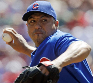 Carlos Zambrano recovers from his rough opening day start to toss seven solid innings in Cincinnati.  (AP)