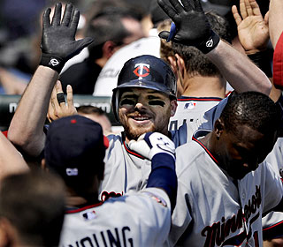 Jason Kubel is a popular man in the Twins clubhouse after his game-winning homer in the seventh. (AP)