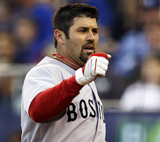 Jason Varitek, in his first start of the season, slams two home runs to support his batterymate Josh Beckett.  (AP)