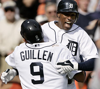A wild pitch leads to a wild celebration for the Tigers, who rally from a 7-1 deficit against the Indians. (AP)