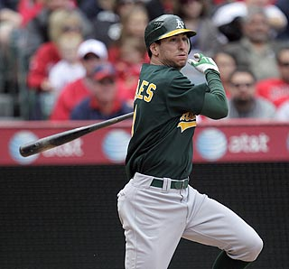 Adam Rosales makes the most of his opportunity by hitting a single that puts the A's ahead to stay. (AP)