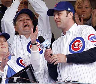 New Cubs owner Tom Ricketts (left) embraces Wrigley culture by singing 'Take Me Out to the Ball Game.'   (AP)