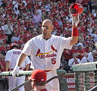 Albert Pujols has a big day with four RBI, a home run, and a curtain call from the St. Louis fans.  (AP)