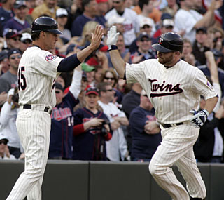 Jason Kubel goes into the Twins record books by hitting the first home run at Target Field.  (AP)