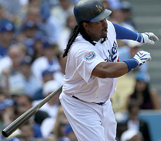 It takes Manny Ramirez seven games to take the ball out of the park for the first time. (Getty Images)
