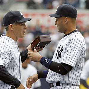 Manager Joe Girardi presents a ring to Derek Jeter, one of four players to earn five with the Yankees. (US Presswire)