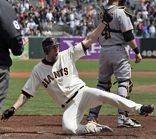 Aubrey Huff records his first home run of the season in style with his long coveted inside-the-park job. (AP)