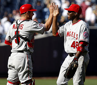 Torii Hunter (right) -- with Jeff Mathis -- says a Mike Scioscia pep talk 'seemed like it worked.' (AP)