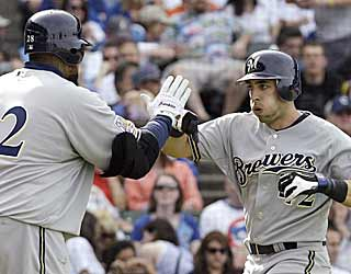Ryan Braun is congratulated by Prince Fielder after drilling a solo homer in eighth inning. (AP)