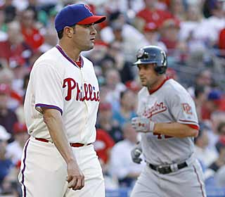 The Phillies' Danys Baez sulks after giving up a pinch-hit home run to Ryan Zimmerman (rear). (AP)