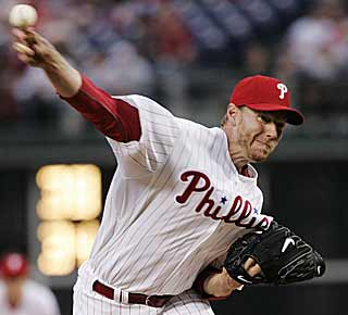 The move to the NL hasn't slowed Roy Halladay. The former Cy Young winner is 3-0 for the Phils. (AP)