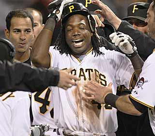 Lastings Milledge gets a warm response from his teammates after his game-winning hit in the ninth. (AP)