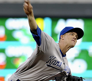 Zack Greinke walks five and gives up six hits in five innings against the Twins.  (AP)