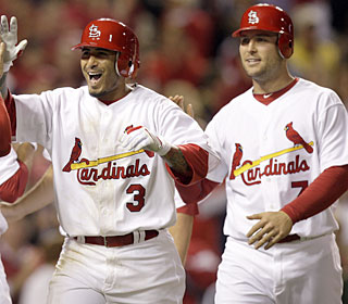Felipe Lopez is all smiles after his fifth career grand slam gives the Cards the lead.  (AP)