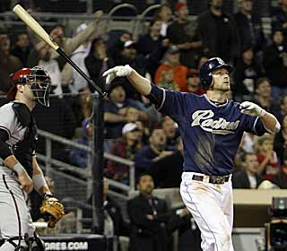 Chase Headley lets the bat fly because he knows his hit just gave the Padres the walk-off win. (AP)