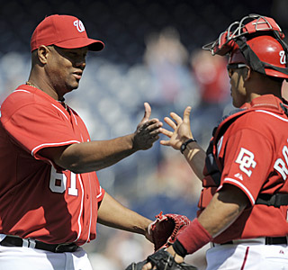 The Nats' 73-year-old battery -- Livan Hernandez, 35, Ivan Rodriguez, 38 -- celebrates the victory.  (AP)