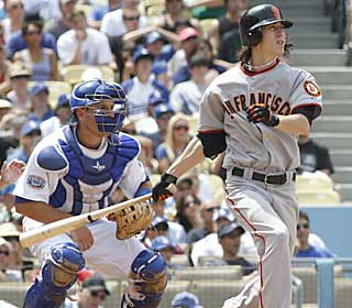 In addition to six scoreless innings, Tim Lincecum finishes with three hits and three RBI. (AP)