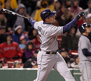 Pat Burrell sends a homer over the Green Monster to give the Rays their fourth straight win.  (Getty Images)