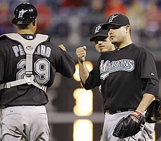 Ricky Nolasco is congratulated after tossing a complete game against the rival Phillies. (AP)