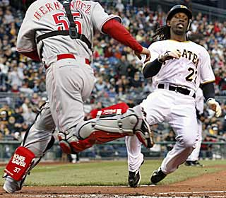Andrew McCutchen slides in safely at home to post the Pirates' first run of the game. (AP)