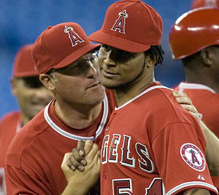 Ervin Santana (54) retires 17 in a row at one point in a dominant complete-game victory in Toronto.   (AP)