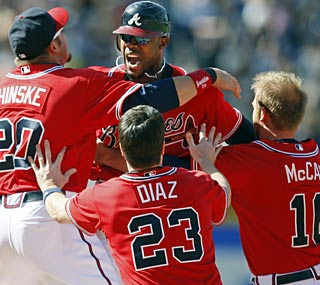 Jason Heyward enjoys his first career game-winning hit and isn't afraid to show it with his teammates.  (AP)