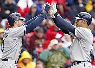 Evan Longoria (left) and Carlos Pena have good reason to celebrate as the Rays down the rival Red Sox again. (AP)