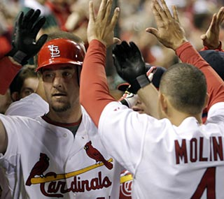 The Cardinals' Ryan Ludwick breaks a 3-3 tie with his two-run shot in the eighth inning.  (AP)