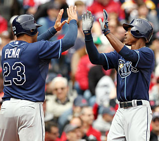 B.J. Upton (right) smacks his fourth home run in five games as the Rays win their seventh in a row.  (AP)
